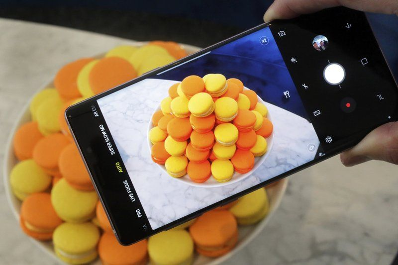 The Samsung Galaxy Note 9 is shown in New York. For $1,000, the Galaxy Note 9 is a superb phone that's the best Samsung has to offer. But for a few hundred dollars less, the Galaxy S9 offers many of the features the Note 9 is now getting, including zippy speeds and camera improvements. (AP Photo/Richard Drew, File)