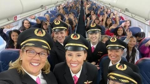 All-women airline crew flies 120 girls to NASA