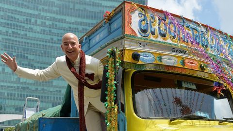 Amazon Boss Jeff Bezos visits India as traders plan protest