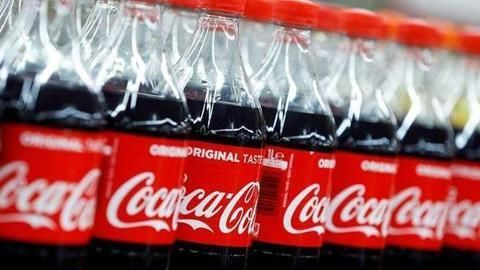 Coca-Cola says customers want plastic bottles