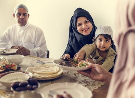 102863196-muslim-family-having-a-ramadan-feast.jpg