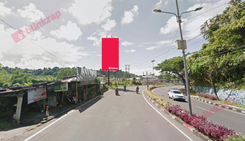 Sewa Billboard - Billboard Jl. A . A  Maramis – Koran Tribun A - kota manado