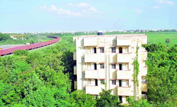 Apartment left unoccupied for a decade at Rail Vihar, Nallpadu in Guntur. (Inset) An abandoned flat filled with files. (Photo: DC)