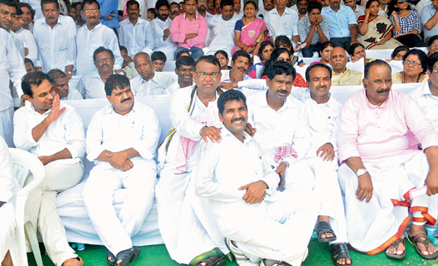 Telangana Cabinet ministers (from left) K.T. Rama Rao, Mahender Reddy, Pocharam Srinivas Reddy, T. Rajaiah (sitting in front), E. Rajender and N. Narasimha Reddy, take part in the celebrations at Parade Grounds on Monday. Photo: Gandhi