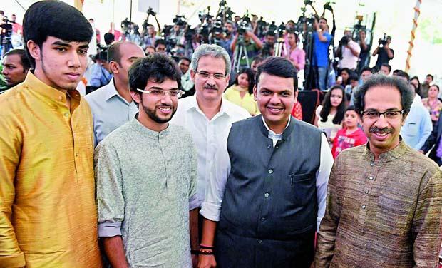 Maharashtra CM Devendra Fhadnavis along with Shiv Sena President Uddhav Thackeray and his sons Tejas and Aditya during the swearing-in ceremony for the new ministers from Shiv Sena in Mumbai on Friday. (Photo: PTI)