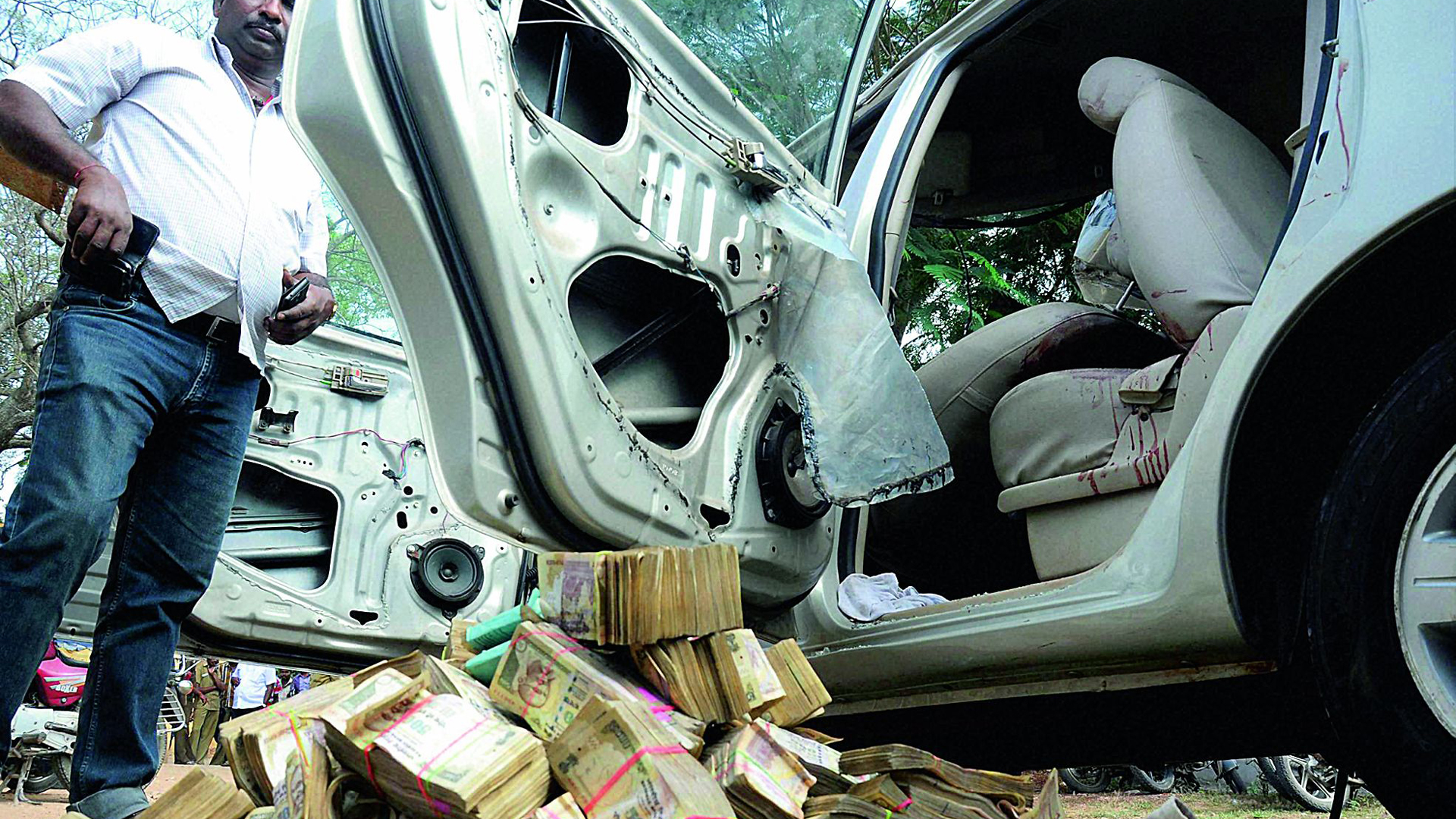 People rush as car spills Rs 2 crore