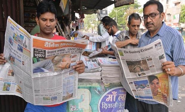 Image result for indians reading newspaper