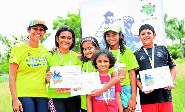 Young achievers: Children who participated in the Novice Triathlon and Mini Aquathlon with their certificates and medals at the Triathlon on Sunday. (Photo:  DC)