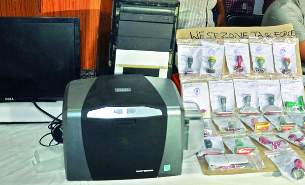 The bank seals, duplicate RCs, NoCs and fake letter heads seized from the gang by the West Zone police on Saturday. (Photo: DC)