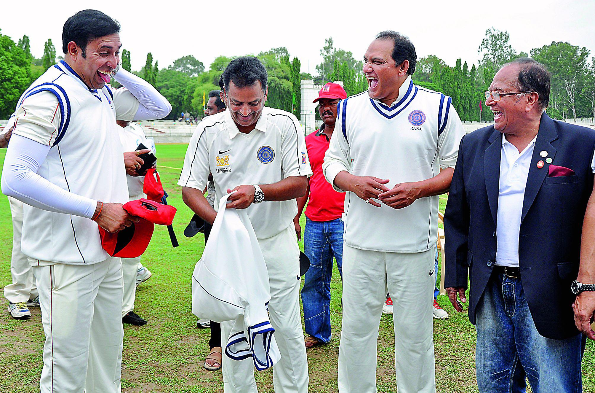 Former Indian cricketers V.V.S. Laxman (from left), Venkatapathy Raju and Mohammad Azharuddin share a light moment at Thapar Stadium at AOC Centre in Secunderabad on Sunday. (Photo: Deepak Deshpande)