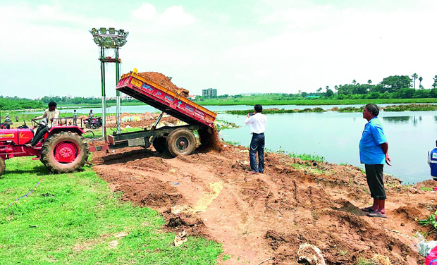DC reader Deepa Kapoor sent this photograph of mud being filled up in the Kapra Lake for Ganesh immersion.