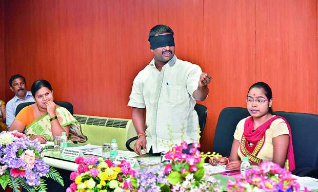 Cantonment Board member Ramakrishna protests at SCB meeting wearing a black blindfold. (Photo: DC)