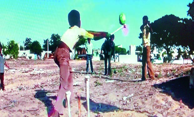 A file photograph of children living near a burial ground playing cricket using a human skull as the ball and a bone as the bat in Bodiganigunta area of Nellore town.