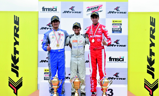 Krishnaraaj Mahadik (left), Yash Aradhya (centre) and Ricky Donison (right) pose with the winners trophy of JK Tyre-FMSCI National Rotax Max Karting Championship second round