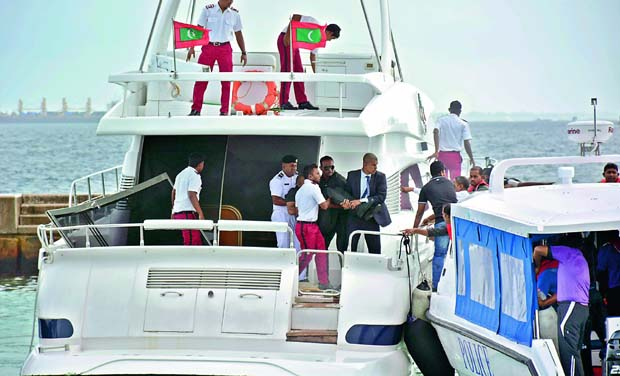 Unidentified injured people are evacuated after a blast on the Maldives President Yameen Abdul Gayoom speedboat in Male on Monday. (Photo: AP)