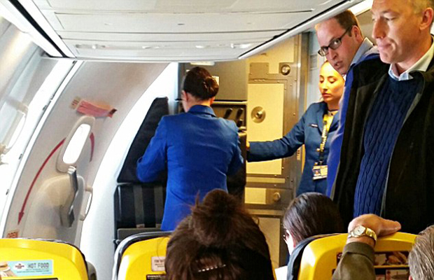 Prince William (pictured right wearing glasses) was seen on a Ryanair flight from Stansted to Glasgow. (Photo: Twitter)