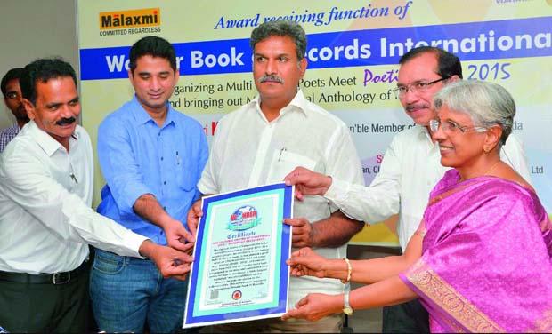 Cultural Centre of Vijayawada CEO E. Sivanagi Reddy and Sandeep Mand-ava receive International Wonder of Records award from Vijayawada MP Kesineni Srinivas on Sunday. Literary adviser Padmaja Iyengar is also seen.