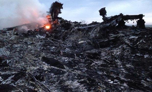 Smoke rises up at a crash site of a passenger plane, near the village of Hrabove, Ukraine. (Photo: AP)