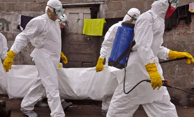 Health workers carry the body of a woman that they suspect died from the Ebola virus, in an area known as Clara Town in Monrovia, Liberia, Wednesday, Sept. 10, 2014. (Photo: AP)