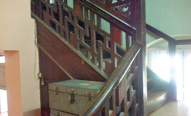 A wooden staircase inside the building. (Photo: DC)