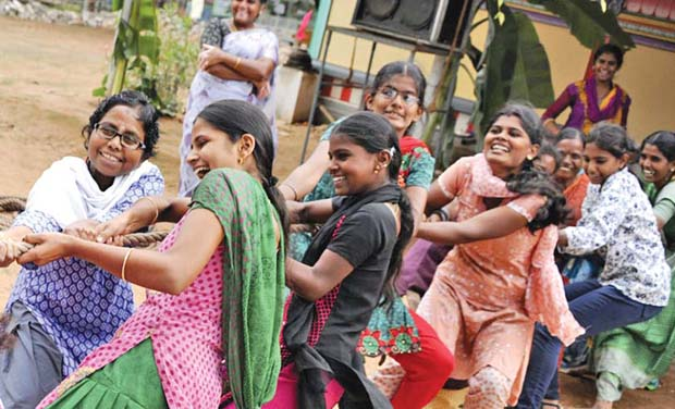 Girls participate in tug-of-war event that was organised as part of Isha Gramotsavam.  (Photo: DC)