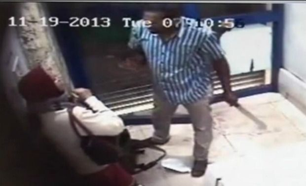 A CCTV image of the attacker attacking the woman with a revolver (on his right hand) and machete (left hand) at an ATM in Bengaluru.