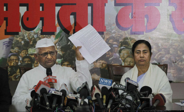 Anti-corruption activist Anna Hazare displays his 17-point agenda as he addresses a joint press conference with West Bengal Chief Minister Mamata Banerjee in New Delhi on Wednesday - PTI