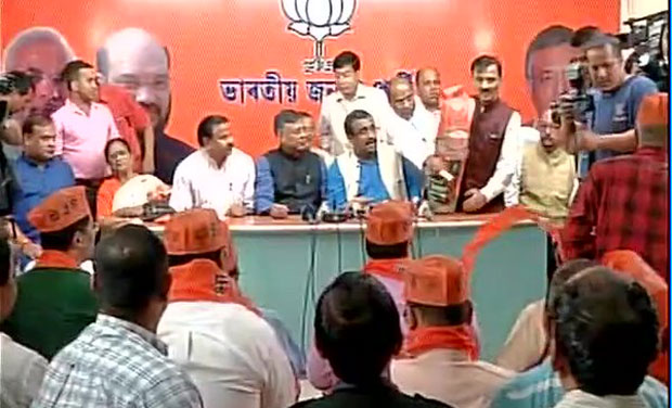 The nine legislators joined BJP at a special function in its state head office attended by the party's national general secretary Ram Madhav, state unit president Sidhartha Bhattacharjee, Himanta and other party leaders. (Photo: ANI/Twitter)