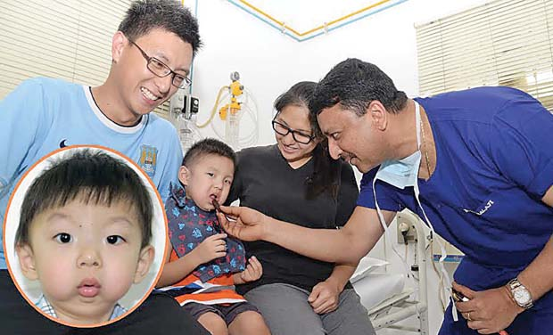 Two-year-old Chayce Lee with parents and doctor. (Photo: DC)