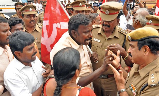 CPI(M) cadres enter into an argument with police while protesting against the state election commission alleging rigging by AIADMK functionaries during the local body byelections in Chennai on Thursday. (Photo: DC)
