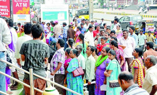 People in large numbers stand in a queue to apply for Aadhaar cards near Dwaraka-nagar in Visakhapatnam on Thursday. (Photo: DC)