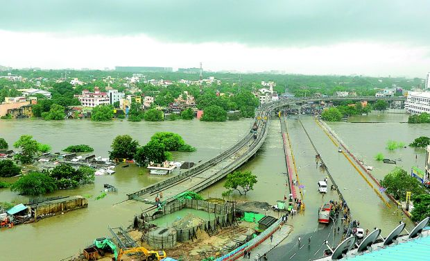 Chennai turned a virtual island and coastal areas of Tamil Nadu were marooned after unprecedented rains in 100 years pounded the city, destroying road and rail links also (Photo: PTI)