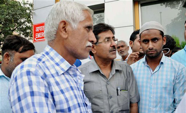 Dadri victim Mohammad Ikhlaq's family members at a hospital where his son Danish is admitted in Noida on Monday. (Photo: PTI)