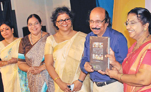 Poet Satchidanandan releases a contemporary encyclopedia of British literature brought out by Dr Kalyani Vallath (centre) by handing over a copy to Prof Jancy James at a function in Thiruvananthapuram on Saturday. Prof Meena T. Pillai and ASAP