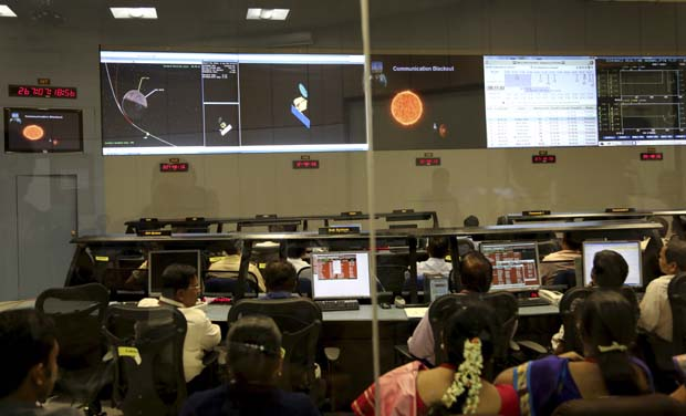 Indian Space Research Organisation scientists watch screens display the graphics explaining Mars Orbiter Mission at their Telemetry, Tracking and Command Network complex in Bangalore (Photo: AP)