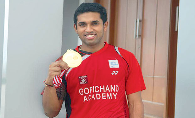 H.S. Prannoy shows off his Indonesian Open Grand Prix gold medal in Hyderabad on Tuesday.