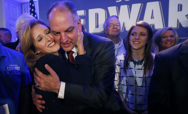 Louisiana Gov.-elect John Bel Edwards hugs his wife Donna Edwards as he arrives to greet supporters at his election night watch party in New Orleans (Photo: AP)