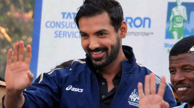 Bollywood actor John Abraham - the face of Standard Chartered Mumbai Marathon since 2004 - said if fitness is religion, marathon is the best medicine. (Photo: PTI)