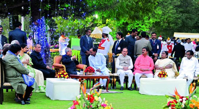 Chief Minister K. Chandrasekhar Rao shares a word with President Pranab Mukherjee at a reception hosted by the latter at Rashtrapati Nilayam on Wednesday. Governor E.S.L. Narasimhan and others are also seen
