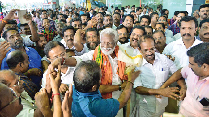 Reception accorded to BJP state president Kummanam Rajasekharan on his arrival at Thiruvananthapuram airport on Friday. (Photo: DC)