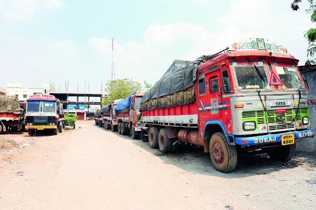 Loaded trucks stationed outside Telangana State Beverages Corporation Limited depot of Peerzadiguda, after the depot was closed. (Photo: DC)