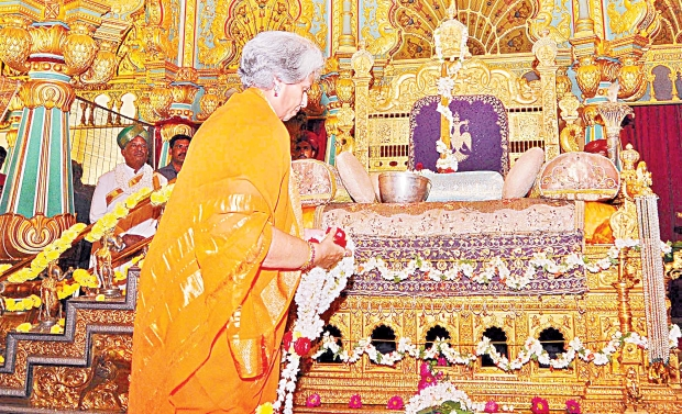 Maharani Pramoda Devi of the Mysore royal family offers puja  to the royal sword placed on the golden throne at Mysore Palace.