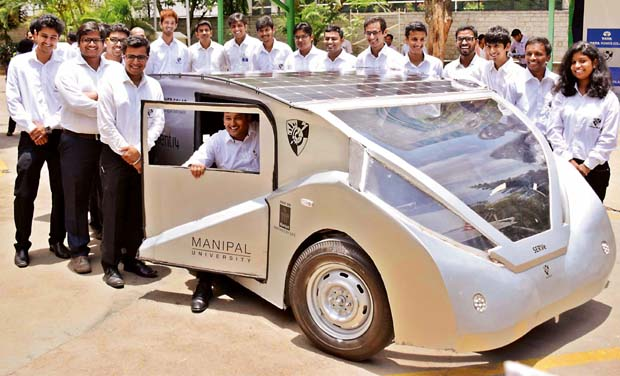 Team members of SolarMobil with Solar Electric Road Vehicle - SERVe - in Bengaluru on Wednesday (Photo: DC)