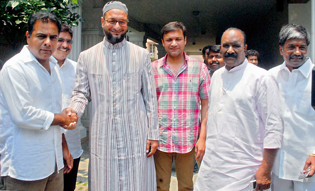 TRS legislator K.T. Rama Rao meets MIM chief and Hyderabad MP Asaduddin Owaisi. (Photo: S. Surender Reddy)