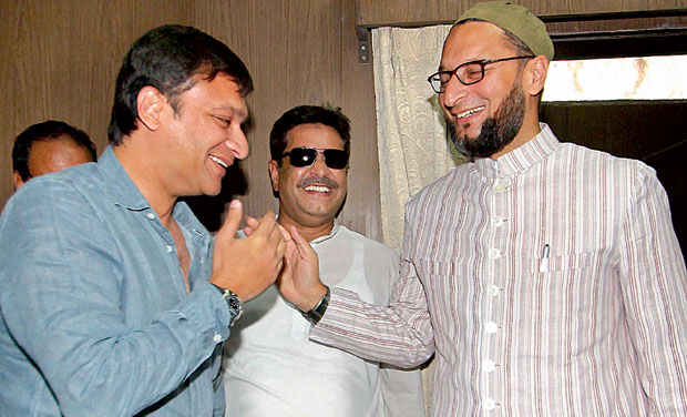 Chandrayangutta MLA Akbaruddin Owaisi (left),  greets MIM president Asaduddain Owaisi (right) in Hyderabad on Friday. (Photo: Deccan Chronicle)