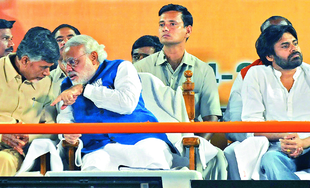 Narendra Modi talks to Telugu Desam chief N. Chandrababu Naidu during his meet . Actor Pawan Kalyan is also seen. Photo: DC
