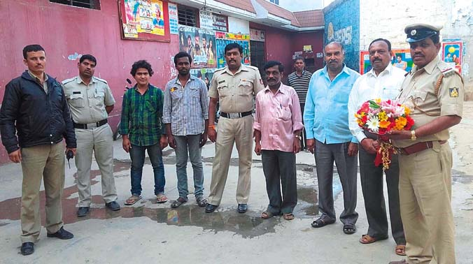 Madivala police along with theatre owners during the screening of community policing in Bengaluru