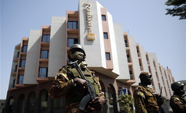 Tight security surrounds Malian President Ibrahim Boubacar Keita as he visits the Radisson Blu hotel in Bamako (Photo: AP)