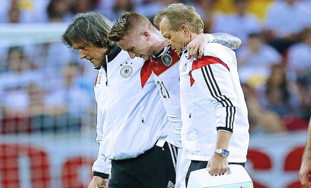 Marco Reus was helped off the pitch by two of the medical staff and taken to hospital in Mainz where scans revealed the damage. Photo: AP