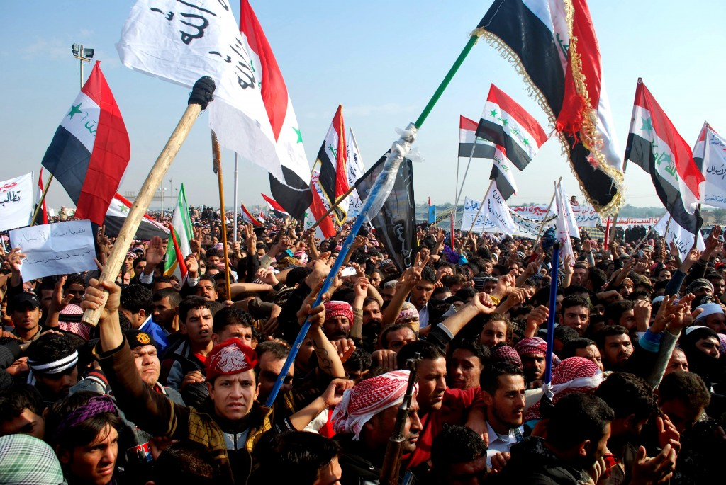 Protesters chant slogans against Iraq's Shiite-led government in Ramadi, 70 miles (115 kilometers) west of Baghdad, Iraq. File Photo- AP